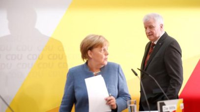 Christian Democratic Union Chancellor Merkel and Christian Social Union Bavaria State Premier Seehofer address a news conference in Berlin