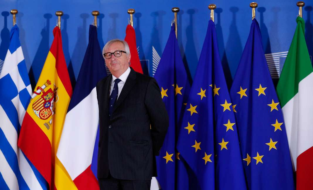 European Commission President Jean-Claude Juncker waits for guests at the start of an emergency European Union leaders summit on immigration in Brussels
